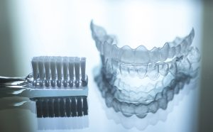 Invisalign braces are a clear set of removable aligners that act much like traditional braces do, placing pressure on the teeth to straighten